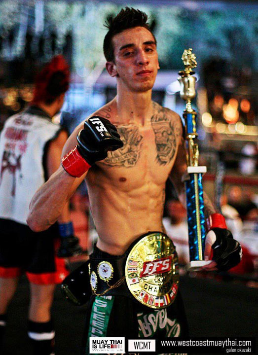 Anthony Cardoza poses with his IFS Championship belt around his waist and trophy in his hand.