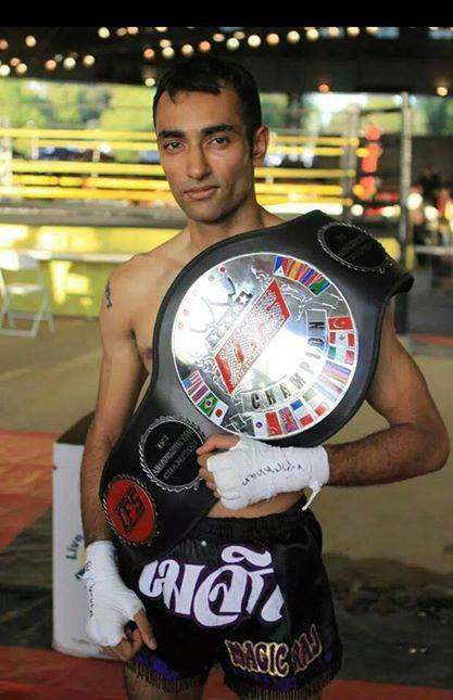 Raj Patel celebrates his win posing with his IFS Championship belt draped over his shoulder.