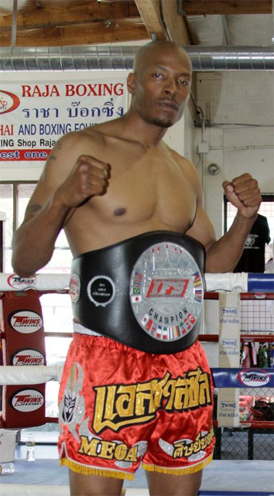 Wearing his IFS Championship belt, Spencer Mix strikes his fight pose.