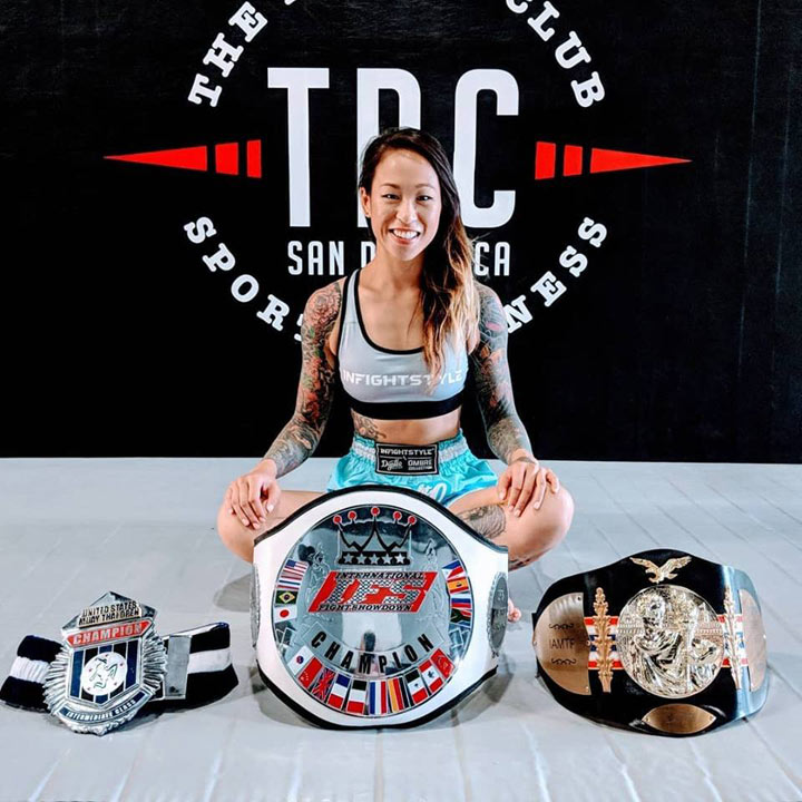 Stephanie Tanguay poses proudly with  three of her championship belts including her IFS belt.