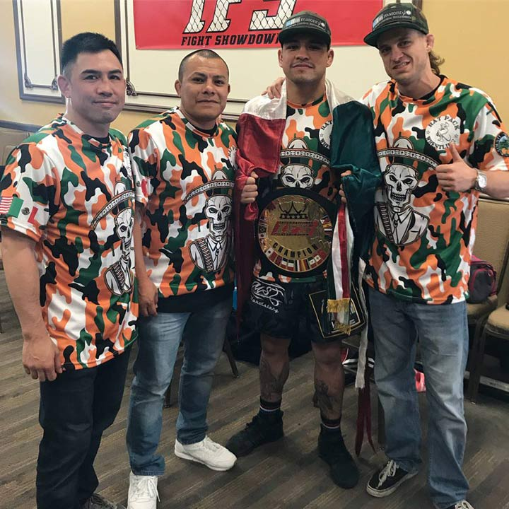 Wearing his IFS Championship belt, Richie Palomino celebrates his win with members of his team.