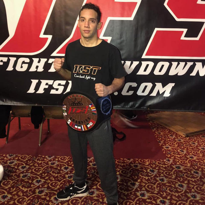 Yannick Krappe poses with his IFS Championship belt around his waist.